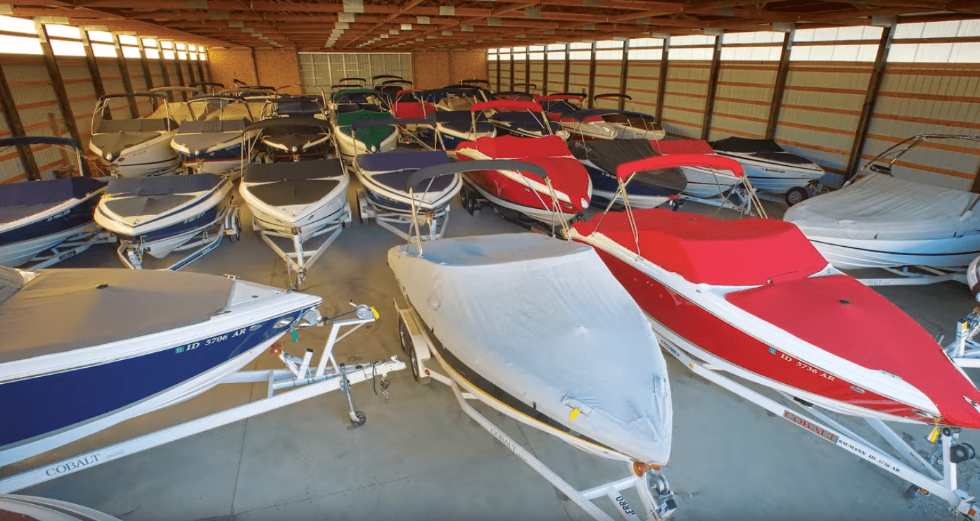 Covered boats in indoor storage